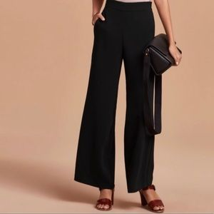 Black wide leg Wilfred pants with side zip.